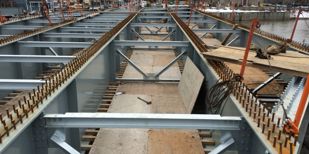 Fabrication of a Steel Bridge with 25 Cambered Beams